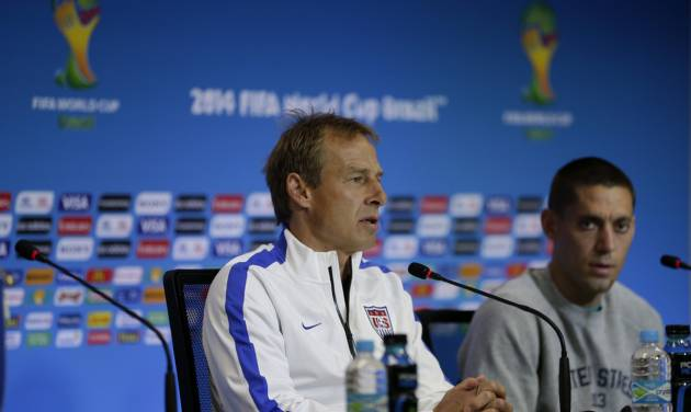 United States' head coach Jurgen Klinsmann, left, speaks flanked by attacker Clint Dempsey during a press conference the day before the World Cup round of 16 soccer match between Belgium and the U.S. at Arena Fonte Nova in Salvador, Brazil, Monday, June 30, 2014. (AP Photo/Julio Cortez)