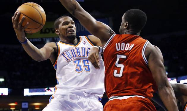 Oklahoma City Thunder forward Kevin Durant (35) shoots defended by Milwaukee Bucks center Ekpe Udoh (5) in the third quarter of an NBA basketball game in Oklahoma City, Saturday, Jan. 11, 2014. Oklahoma City won 101-85. (AP Photo/Sue Ogrocki)
