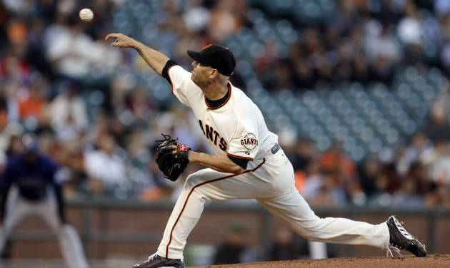 San Francisco Giants' Tim Hudson works against the Colorado Rockies in the first inning of a baseball game Wednesday, Aug. 27, 2014, in San Francisco. (AP Photo/Ben Margot)