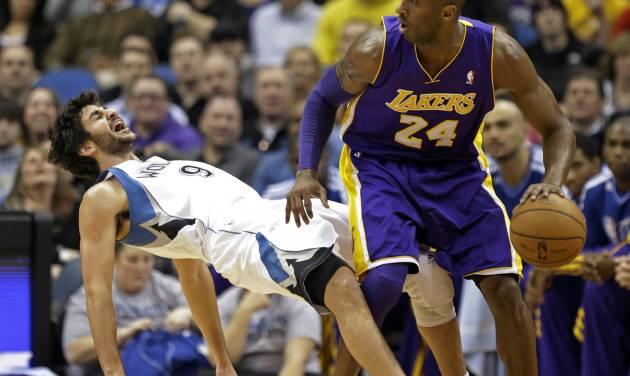 Minnesota Timberwolves' Ricky Rubio left, of Spain, falls to the floor after a called charge on Los Angeles Lakers' Kobe Bryant in the first quarter of an NBA basketball game Friday, Feb. 1, 2013, in Minneapolis. (AP Photo/Jim Mone)