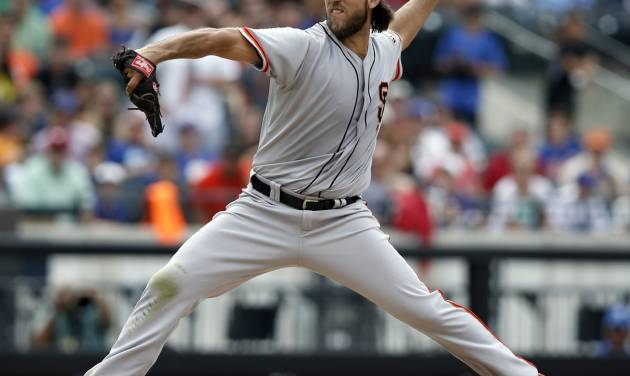 San Francisco Giants starting pitcher Madison Bumgarner delivers in the ninth-inning of his 9-0, complete-game shutout of the New York Mets in a baseball game, in New York, Sunday, Aug. 3, 2014. (AP Photo/Kathy Willens)