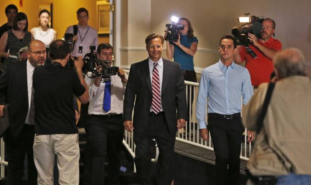 Republican 7th District congressional candidate Dave Brat, center, arrives for a Rotary Club breakfast in Richmond, Va., Tuesday, June 17, 2014.  Brat defeated House Majority Leader Eric Cantor in last week's Republican primary. (AP Photo/Steve Helber)