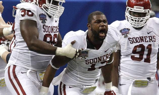 Oklahoma's Eric Striker (19) celebrates his sack of Alabama's AJ McCarron (10) and Oklahoma's Chuka Ndulue (98) and Charles Tapper (91) look on during the NCAA football BCS Sugar Bowl game between the University of Oklahoma Sooners (OU) and the University of Alabama Crimson Tide (UA) at the Superdome in New Orleans, La., Thursday, Jan. 2, 2014.  .Photo by Sarah Phipps, The Oklahoman
