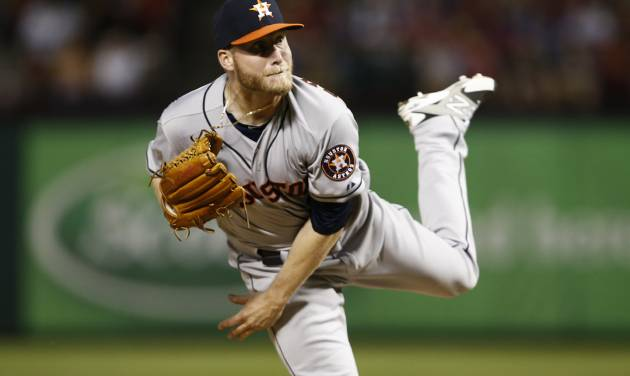 Houston Astros relief pitcher Kevin Chapman (66) throws to the Texas Rangers during the ninth inning of a baseball game, Friday, April 11, 2014, in Arlington, Texas. The Rangers won 1-0. (AP Photo/Jim Cowsert)