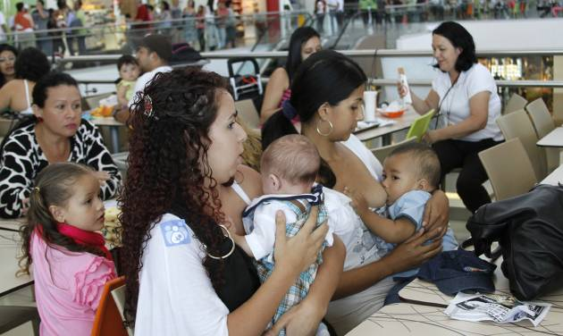 Costa Rican women breast feed their babies during a pro-breastfeeding demonstration at the Plaza Lincoln shopping center in San Jose, Costa Rica, Saturday, Jan. 12, 2013. At least 50 mothers gathered in the mall's fast food area and breastfed infants for nearly two hours Saturday, protesting over the shopping center forcing a woman to stop nursing her daughter a week earlier.  (AP Photo/Enrique Martinez)