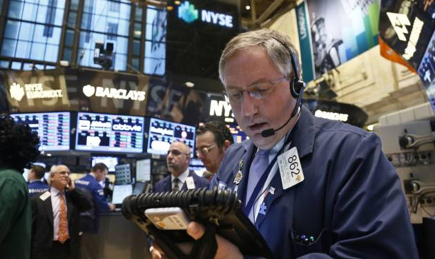 Warren Meyers, a trader for DME Securites, monitors trading activity from his mobile workstation at the New York Stock Exchange on Wednesday, Feb. 20, 2013.   Stock market indexes flipped between small gains and losses early after the U.S. government reported that housing construction slowed down during the first month of the year.  (AP Photo/Bebeto Matthews)