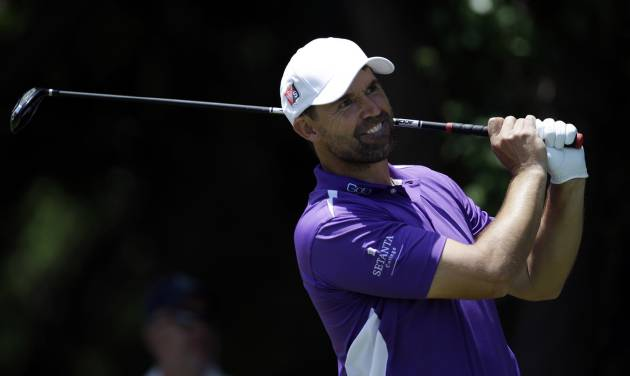 Padraig Harrington of Ireland follows his shot off the first tee during the final round of the Byron Nelson Championship golf tournament, Sunday, May 18, 2014, in Irving, Texas. (AP Photo/Tony Gutierrez)