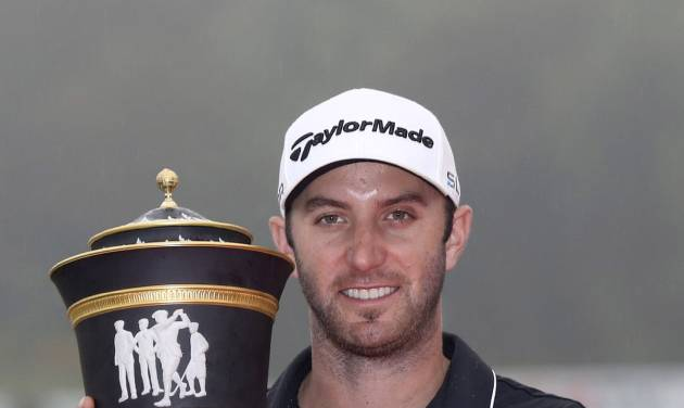 Dustin Johnson of the United States holds his champion trophy during the award ceremony of the HSBC Champions golf tournament at the Sheshan International Golf Club in Shanghai, China, Sunday, Nov. 3, 2013. Against an all-world cast of contenders, Johnson pulled away with power and a clutch putt to win his first World Golf Championship on Sunday. (AP Photo/Eugene Hoshiko)