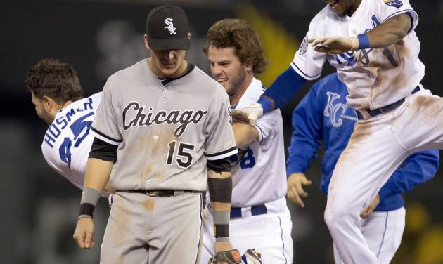 Chicago White Sox second baseman Gordon Beckham (15) walks off the field while Kansas City Royals' Eric Hosmer (35), Mike Moustakas (8) and Jarrod Dyson (1) celebrate during the ninth inning of a baseball game at Kauffman Stadium in Kansas City, Mo., Thursday, Sept. 20, 2012. Hosmer singled and Dyson scored the winning run as the Royals defeated the White Sox 4-3. (AP Photo/Orlin Wagner)