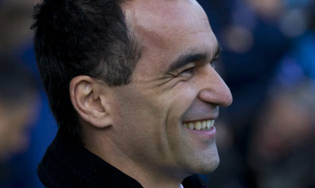Everton's manager Roberto Martinez smiles as he takes to the touchline before his team's English Premier League soccer match against West Ham United at Goodison Park Stadium, Liverpool, England, Saturday March 1, 2014. (AP Photo/Jon Super)