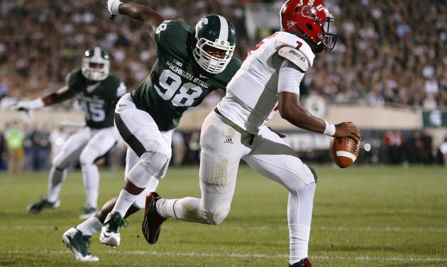 Michigan State defensive end Demetrius Cooper (98) chases Jacksonville State quarterback Eli Jenkins (7) during the first half of an NCAA college football game in East Lansing, Mich., Friday, Aug. 29, 2014. (AP Photo/Paul Sancya)