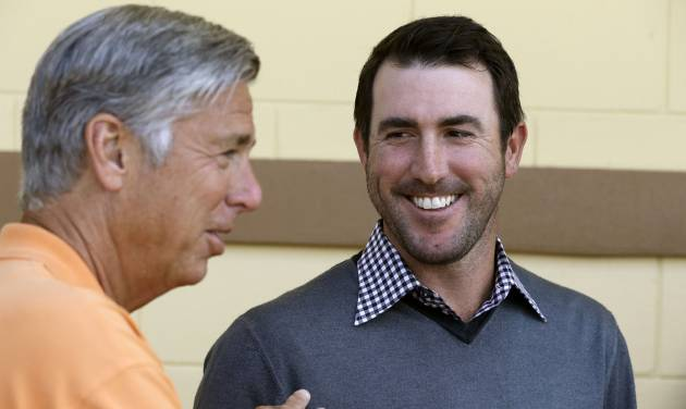 Detroit Tigers pitcher Justin Verlander, right, looks at team president, CEO and general manager Dave Dombrowski during a news conference after a spring baseball exhibition game on Friday, March 29, 2013, in Lakeland, Fla., where Verlander talked about his new seven-year, $180-million contract. (AP Photo/Carlos Osorio)