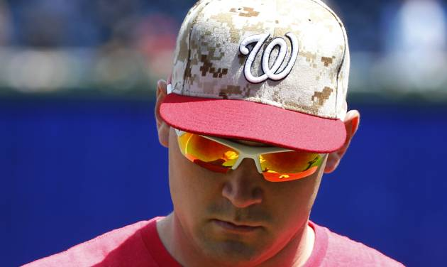 Washington Nationals Ryan Zimmerman looks at his hand after playing catch before a baseball game against the Miami Marlins at Nationals Park Monday, May 26, 2014, in Washington. Zimmerman is on the disabled list with an injured right thumb. (AP Photo/Alex Brandon)