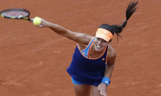 Serbia's Anna Ivanovic serves the ball during the second round match of the French Open tennis tournament against Ukraine's Elina Svitolina at the Roland Garros stadium, in Paris, France, Thursday, May 29, 2014. (AP Photo/Darko Vojinovic)