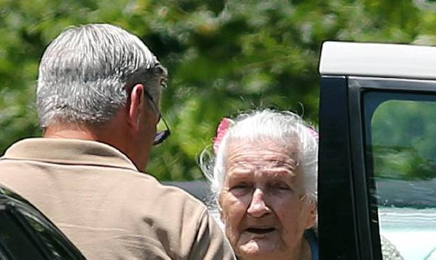 James Duncan talks to his 97-year-old mother while moving her out of Alzheimer's Care of Commerce Tuesday, July 2, 2013 after officials executed an early morning search warrant on the facility. The GBI announced that 21 people at the facility were being charged with abusing residents there. Duncan said that he was shocked by the charges and had never suspected any problems. (AP Photo/The Atlanta Journal-Constitution, Ben Gray)