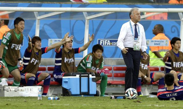 Japan's head coach Alberto Zaccheroni, stands on the touchline as his bench appeal for a foul during the group C World Cup soccer match between Japan and Colombia at the Arena Pantanal in Cuiaba, Brazil, Tuesday, June 24, 2014. (AP Photo/Thanassis Stavrakis)