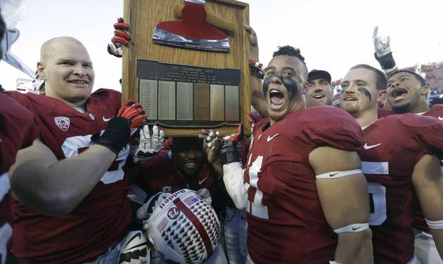 Stanford's Trent Murphy (93) and Shayne Skov (11) celebrate with The Stanford Axe after a win over California in an NCAA college football game in Stanford, Calif., Saturday, Nov. 23, 2013. Stanford won 65-13. (AP Photo/Tony Avelar)