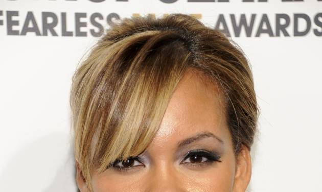 """FILE - This March 7, 2011 file photo shows Evelyn Lozada posed at the Cosmopolitan Magazine's 'Fun Fearless Males of 2011' event in New York. As the Miami Dolphins took the field for practice Sunday, Aug. 12, 2012, Chad Johnson was getting out of jail. Hours later, he was out of work. The Dolphins terminated the six-time Pro Bowl receiver's contract about 24 hours after he was arrested in a domestic battery case involving his wife. The confrontation came barely a month after Johnson married Evelyn Lozada, who is on the reality TV show """"Basketball Wives."""" (AP Photo/Evan Agostini, File)"""