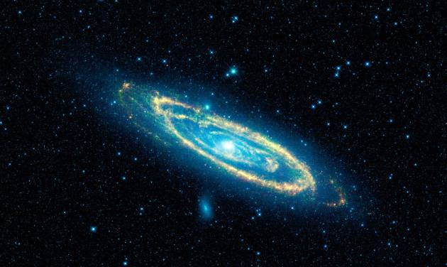 This image provided by NASA shows the immense Andromeda galaxy, also known as Messier 31, captured in full in this new image from NASA's Wide-field Infrared Survey Explorer, or WISE. Astronomers are  looking for thousands of Internet volunteers, to identify and count clusters of stars of the Andromeda galaxy. Astronomers from Utah to Europe say it would take them too long to study that many images and they need help. (AP Photo/NASA)
