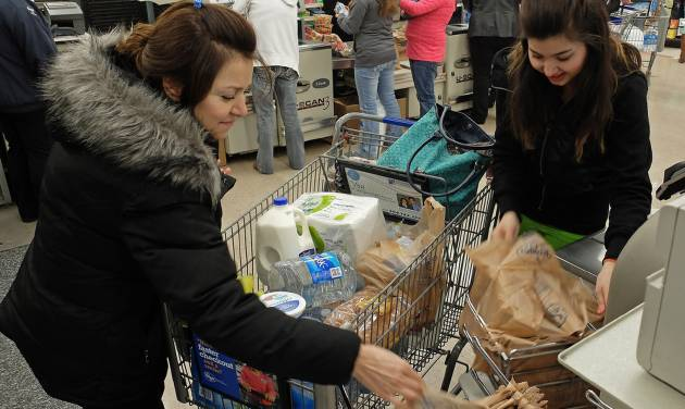 Tanaz Rahin and her mother Farri Rahin of Charleston, W.Va., drove across town to the Kroger in South Charleston, W.Va., to find water following a chemical spill on the Elk River that compromised the public water supply to eight counties on Thursday, Jan. 9, 2014. (AP Photo/Tyler Evert)