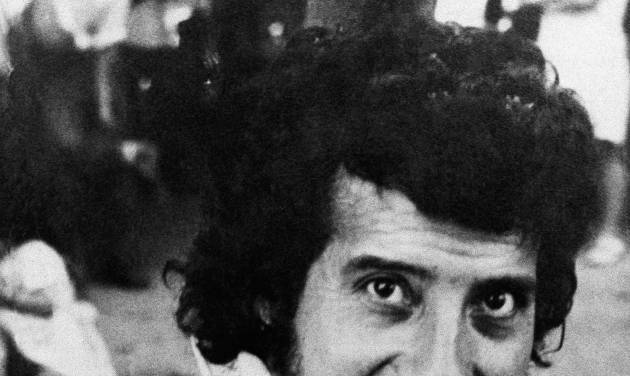 FILE - In this undated file photo, singer and songwriter Victor Jara poses for a photo in Chile. A Chilean court on Friday, Dec. 28, 2012, charged eight former army lieutenants in the killing of Jara almost four decades ago. Jara was detained along with many others at Chile's State Technical University the day after the Sept. 11, 1972 coup that toppled President Salvador Allende. His body was found several days later, riddled with bullets and bearing signs of torture. The killing transformed Jara into a symbol of struggle against Latin America's military right-wing dictatorships. (AP Photo, File)
