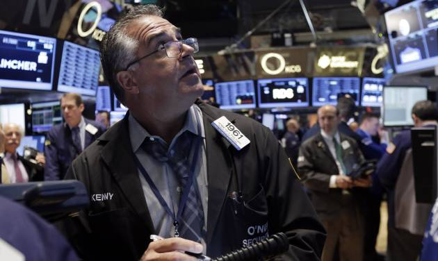 Trader Kenneth Polcari works on the floor of the New York Stock Exchange Thursday, March 13, 2014. Stocks opened higher as traders were encouraged by a pickup in retail sales and more signs of health in the U.S. job market. (AP Photo/Richard Drew)