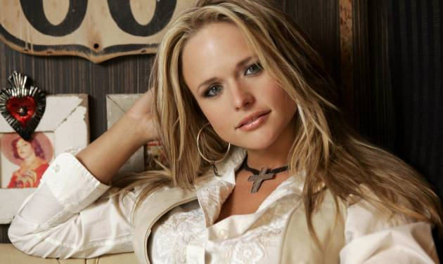 FILE - In this March 21, 2007 file photo, Miranda Lambert is shown on her tour bus in Nashville, Tenn. Lambert and Tim McGraw are the top nominees for this year's Academy of Country Music Awards. Lambert and McGraw are up for seven awards apiece at the April 6 awards show. The nominations were announced Wednesday morning in a series of videos via social media. (AP Photo/Mark Humphrey)