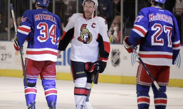 Ottawa Senators' Daniel Alfredsson, center, of Sweden, shakes hands with New York Rangers' John Mitchell (34) and Ryan McDonagh (27) after the Rangers defeated the Senators 2-1 in Game 7 of a first-round NHL hockey Stanley Cup playoff series on Thursday, April 26, 2012, in New York. (AP Photo/Julio Cortez)