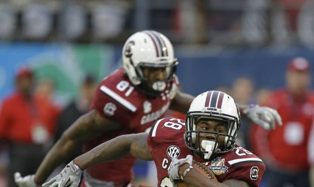FILE - In this Jan. 1, 2014 file photo, South Carolina running back Mike Davis (28) gains yardage against Wisconsin during the second half of the Capital One Bowl NCAA college football game in Orlando, Fla. Davis knows the NFL is on the horizon. First, though, is the chance to improve on one of the best rushing seasons in Gamecock history. (AP Photo/John Raoux, File)
