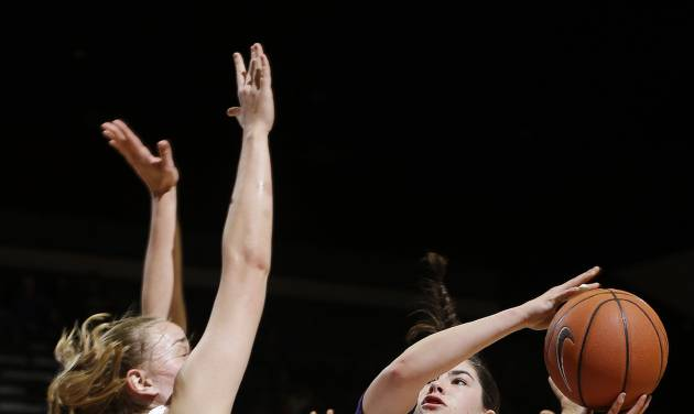 Washington guard Kelsey Plum (10) shoots next to Stanford forward Mikaela Ruef during the first half of an NCAA college basketball game on Thursday, Feb. 27, 2014, in Stanford, Calif. (AP Photo/Marcio Jose Sanchez)