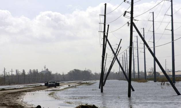 A truck is stranded from receding flood waters from Hurricane Isaac along Louisiana Hwy 23 near Port Sulphur, La., in Plaquemines Parish, Monday, Sept. 3, 2012. The nation's oil and gas hub is slowly coming back to life in the aftermath of Hurricane Isaac. The government said Monday that offshore oil and gas platforms are beginning to ramp up production as crews are returning. (AP Photo/Matthew Hinton)