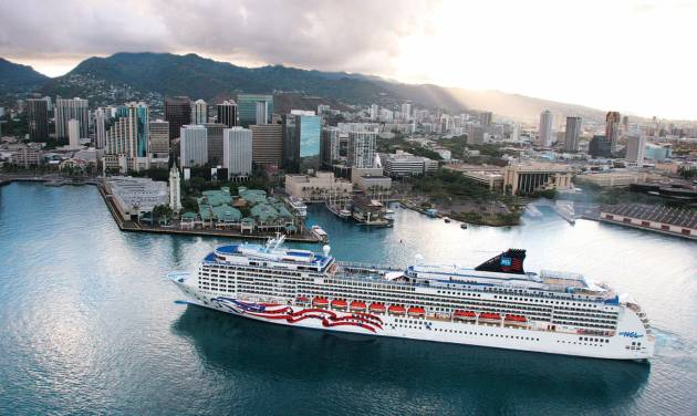 This undated image provided by Norwegian Cruise Line shows an aerial view of the Norwegian ship Pride of America in Honolulu. The ship sails year-round from Honolulu on Oahu to various ports on the Big Island, Maui and Kauai. A cruise is an easy way to see the Hawaiian islands without having to fly between them. (AP Photo/Norwegian Cruise Line)