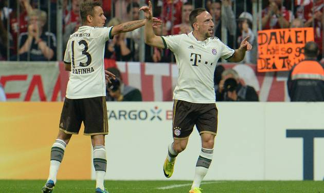 Munich's Rafinha of Brazil. left, and Franck Ribery of France celebrate after scoring during the German soccer cup second round match between FC Bayern Munich and Hannover 96, in Munich, southern Germany, Wednesday, Sept. 25, 2013. (AP Photo/Kerstin Joensson)