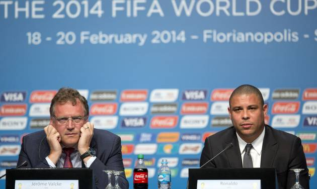 Ronaldo, right, Brazil's former soccer player and a member of the local organizing committee for the 2014 World Cup, and FIFA Secretary General Jerome Valcke attend a news conference during the Team Workshop for the 2014 World Cup at the Costao do Santinho hotel in Florianopolis, Brazil, Friday, Feb. 21, 2014. Ronaldo was on hand to address the problem with the fanfests, which allows fans without tickets to watch matches for free on large screens in public areas. City officials in the northeastern city of Recife said they will not spend money to hold the fanfest event. (AP Photo/Andre Penner)