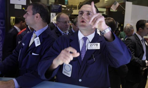 FILE -- In a July 26, 2012 file photo specialist Michael Gagliano works at his post on the floor of the New York Stock Exchange. U.S. stocks edged higher Monday Aug. 6, 2012, on a day marked by uncharacteristic quiet following a turbulent week. (AP Photo/Richard Drew)