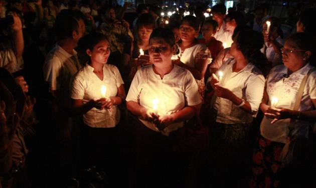 Protesters hold candles during a candlelight vigil in downtown Yangon, Myanmar, Tuesday, May. 22, 2012. Myanmar's government made an uncharacteristic plea for understanding Tuesday after chronic power cuts set off rare protests in the Southeast Asian country that is easing toward democracy after decades of military rule. (AP Photo/Khin Maung Win)