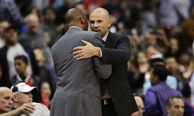 Los Angeles Clippers' Doc Rivers, left, and Brooklyn Nets' Jason Kidd hug after an NBA basketball game on Saturday, Nov. 16, 2013, in Los Angeles. The Clippers won 110-103. (AP Photo/Jae C. Hong)