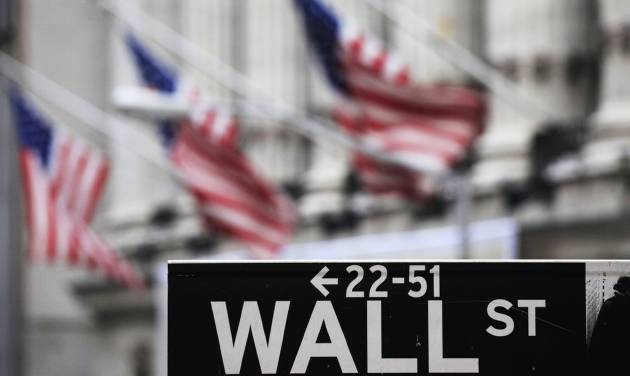 FILE - This April 22, 2010, file photo, shows a Wall Street sign in front of the New York Stock Exchange. Global stock markets mostly inched higher Monday, June 30, 2014, as investors prepared for a busy week of economic news that will give new clues about the strength of the global recovery. Wall Street was set for a tepid session. (AP Photo/Mark Lennihan, File)