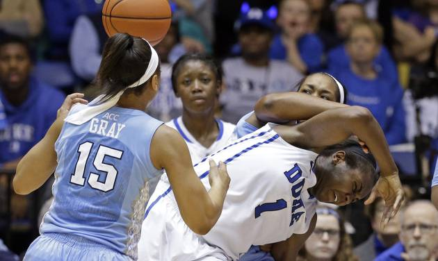 North Carolina's Allisha Gray (15) and Stephanie Mavunga guard Duke's Elizabeth Williams (1) during the second half of an NCAA college basketball game in Durham, N.C., Monday, Feb. 10, 2014. North Carolina won 89-78. (AP Photo/Gerry Broome)