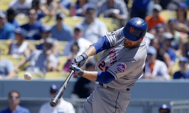 New York Mets' Lucas Duda hits a three-run home run during the third inning of a baseball game against the Los Angeles Dodgers, Sunday, Aug. 24, 2014, in Los Angeles. (AP Photo/Mark J. Terrill)