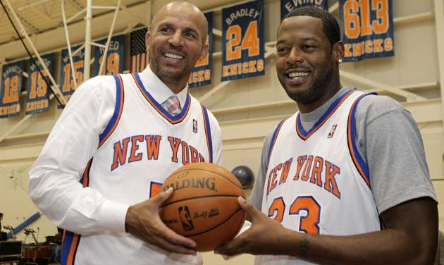 Jason Kidd, left, and Marcus Camby pose for a photograph following a news conference to introduce the New York Knicks newest additions at the team's NBA basketball training facility in Tarrytown, N.Y., Thursday, July 12, 2012. This is Camby's second stint as a member of the Knicks. (AP Photo/Kathy Willens)
