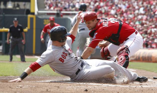 Boston Red Sox' Daniel Nava, left, scores in front of Cincinnati Reds catcher Devin Mesoraco, right, after a Mike Napoli ground ball in the first inning of a baseball game, Wednesday, Aug. 13, 2014, in Cincinnati. (AP Photo/David Kohl)