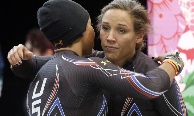 The team from the United States USA-3, pilot Jazmine Fenlator, left, and brakeman Lolo Jones, hug after their second run during the women's two-man bobsled competition at the 2014 Winter Olympics, Tuesday, Feb. 18, 2014, in Krasnaya Polyana, Russia. (AP Photo/Dita Alangkara)