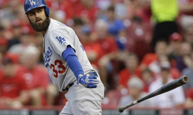 Los Angeles Dodgers left fielder Scott Van Slyke walks in the fourth inning of a baseball game against the Cincinnati Reds, Monday, June 9, 2014, in Cincinnati. Van Slyke has hit two home runs in the game. (AP Photo/Al Behrman)