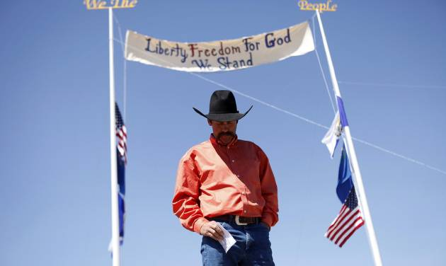 """Rancher Derrel Spencer speaks during a rally in support of Cliven Bundy near Bunkerville Nev. Monday, April 7, 2014, 2014. The Bureau of Land Management has begun to round up what they call """"trespass cattle"""" that rancher Cliven Bundy has been grazing in the Gold Butte area 80 miles northeast of Las Vegas. (AP Photo/Las Vegas Review-Journal, John Locher)"""