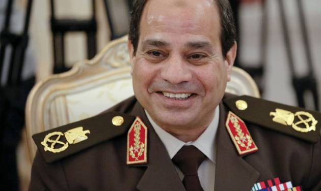 FILE - In this Thursday, Feb. 13, 2014 file photo, Egypt's military chief Field Marshal Abdel-Fattah el-Sissi smiles as he speaks to Foreign Minister Sergey Lavrov during their talks along with Egyptian Foreign Minister Nabil Fahmy and Russian Defense Minister Sergei Shoigu in Moscow, Russia. Former military chief Abdel-Fattah el-Sissi, if he wins Egypt's presidency as is widely expected, will have an overwhelming presence over a shattered political scene. Egypt's once dominant political force, the Muslim Brotherhood, is exhausted under a relentless crackdown. Non-Islamist parties are weak and largely acquiescent to his power. But the political vacuum is hardly a stable one.  The Brotherhood is betting that with time the public will turn against el-Sissi. (AP Photo/Alexander Zemlianichenko, File)