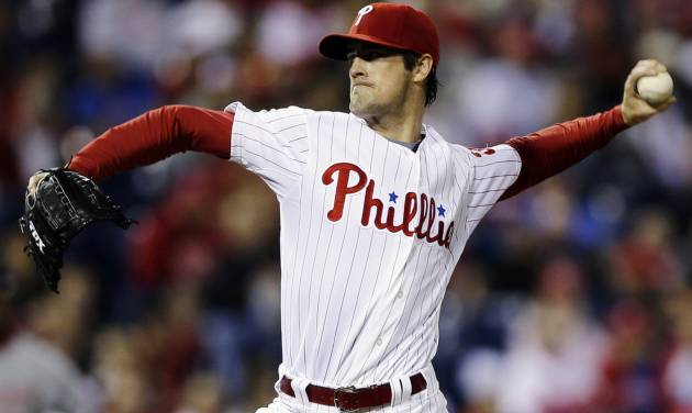 Philadelphia Phillies' Cole Hamels pitches in the third inning of a baseball game against the Washington Nationals, Tuesday, Sept. 25, 2012, in Philadelphia. (AP Photo/Matt Slocum)
