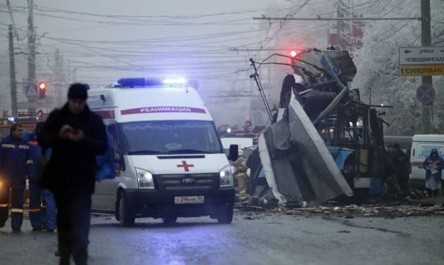 FILE - In this Monday, Dec. 30, 2013 file photo an ambulance leaves the site of an explosion after a bomb blast tore through the trolleybus, background, in the city of Volgograd. A series of unexplained killings in southern Russia involving booby-trapped bombs has further heightened security fears ahead of next month's Winter Olympics in Sochi. A spokesman for Russia's main investigative agency, said in a statement that no motive had yet been found for killings on Wednesday Jan. 8, 2014 on the outskirts of Pyatigorsk, which is the center of an administrative district created in 2010 to coordinate efforts to combat the insurgency.  (AP Photo/Denis Tyrin, File)
