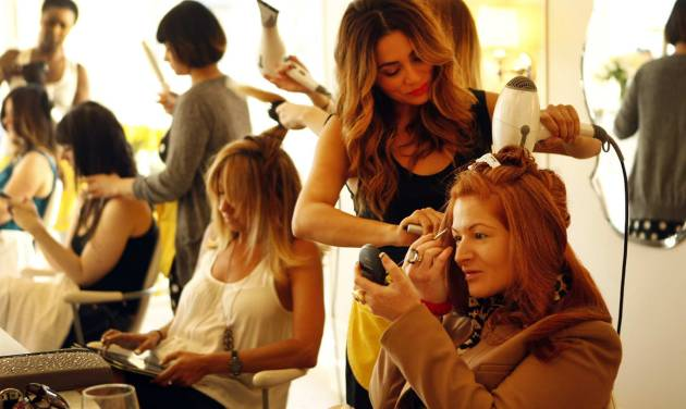 Gina Tennen, right, does her makeup as stylist Lorena Soria uses a blow dryer on her hair at Drybar salon located at 8595 West Sunset Boulevard West Hollywood, July 31, 2012. Drybar is an LA-based chain of blow dry salons, which specialize in wash only and blow dry hair.  (Al Seib/Los Angeles Times/MCT)
