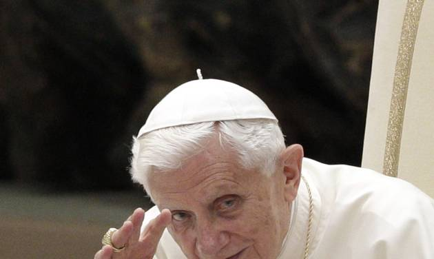 Pope Benedict XV waves during his weekly general audience in the Paul VI hall at the Vatican, Wednesday, Sept. 12, 2012. (AP Photo/Riccardo De Luca)